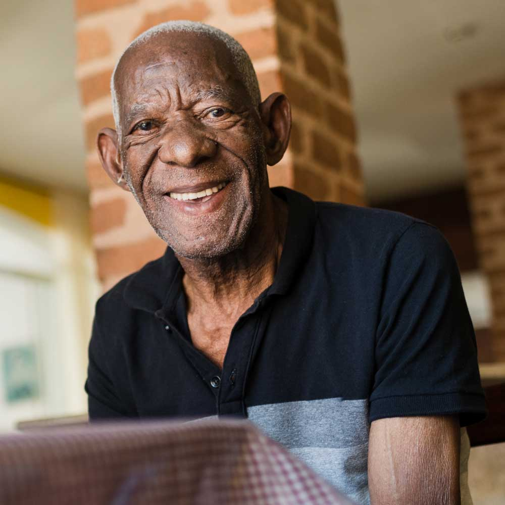 Male Chatham Place Memory Care Resident at a table