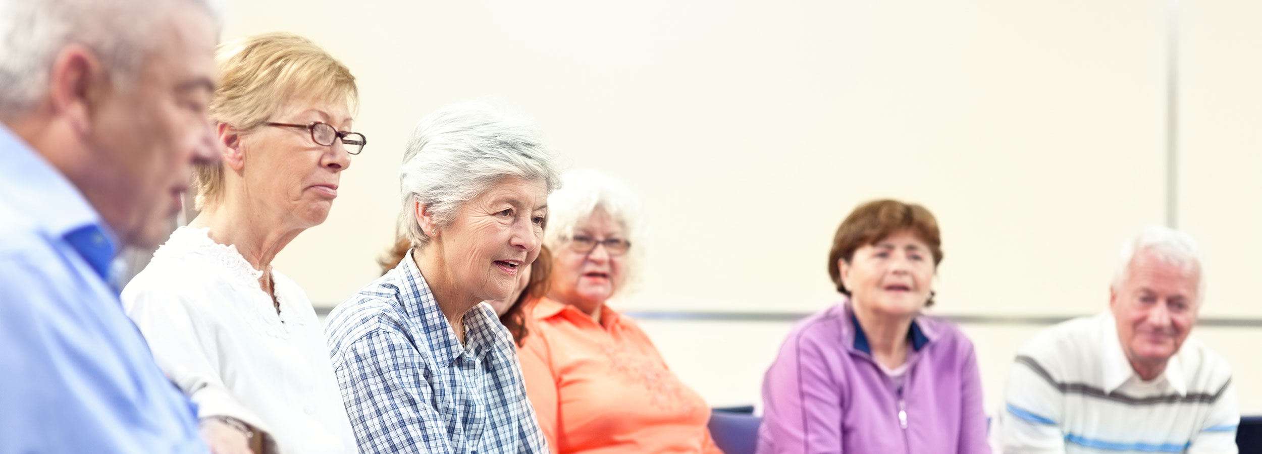 Group of caregivers attending a support group session